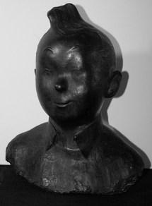 Tintin. Buste en Bronze, réalisé en 1953 sous la direction d'Hergé. Edition justifiée, CP, signée et datée 53. Fonderie D'Arte de Andreis à Milan, avec certificat de l'artiste.